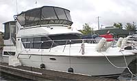 1989 Sea Ray 340 Express sold in the Lindsay area northeast of Toronto, Ontario, Canada by Ontario boat and yacht brokers.