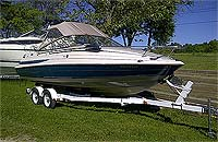 2003 Four Winns 205 Horizon Cuddy with factory trailer for sale in the Lindsay area northeast of Toronto, Ontario, Canada.
